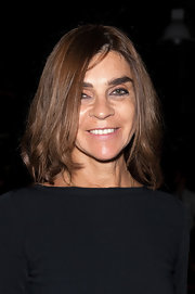 Carine Roitfeld topped off her look with a tousled 'do with wavy ends when she attended the Theyskens' Theory fashion show.