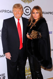 Melania Trump completed her fierce look with a leopard-print clutch.