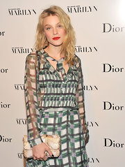 Jessica Stam attended the opening of 'Picturing Marilyn' carrying a Miss Dior python clutch.
