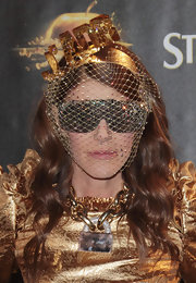 Anna dello Russo topped off her gleaming ensemble with a veiled J'ADR fascinator when she attended the Gold Experience event.