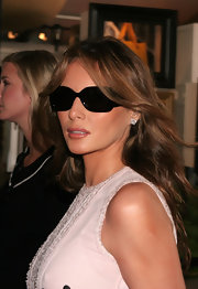 Melania Trump hid her eyes behind a pair of rectangular shades while out during Olympus Fashion Week.