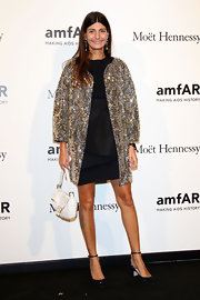 Giovanna Battaglia added more glitter to her look with a beaded white Fendi purse.