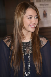 Miley Cyrus accessorized with a chic silver beaded necklace.