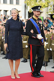 Princess Mette-Marit was classic and chic in a midnight-blue lace dress at the wedding of Prince Guillaume and Princess Stephanie of Luxembourg.