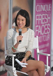 Eva Chen accessorized her outfit with a jade bangle bracelet.