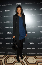 Liya Kebede added some warmth with a black wool coat.