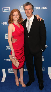 Mireille Enos toned down her standout red dress by styling it with nude pieces -- a long leather clutch and a pair of patent platform peep-toes.