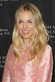 Sienna Miller wore her hair loose with piecey, wavy layers at the BAFTA Los Angeles tea party.