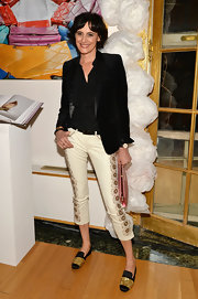 Model Ines de la Fressange attended the Roger Vivier and Rizolli NYC book launch wearing a ruffle top, a leather collared blazer and a pair of floral pants.