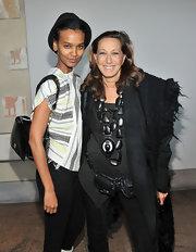 Liya Kebede accessorized with a black patent leather shoulder bag when she attended the Tribute to the Models of Versailles 1973 event.
