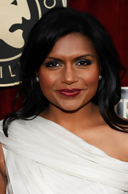 For a dose of sparkle, Mindy Kaling accessorized with a pair of oversized diamond studs.