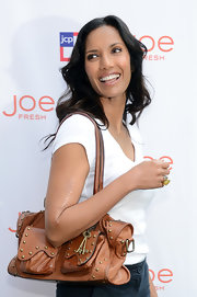 Padma Lakshmi arrived for the jcpenney + Joe Fresh Kids event carrying a studded tan shoulder bag.
