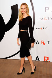 Lauren Santo Domingo chose simple black patent pumps to complete her outfit.