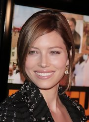 Jessica Biel accessorized with dangling diamond earrings for a touch of glamour.