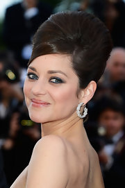 Marian Cotillard accessorized with diamond hoops for the 66th Annual Cannes Film Festival premiere of 'Blood Ties'.