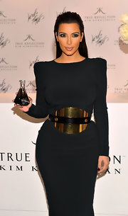 Kim Kardashian's Tom Ford oversized metal and leather belt gave her LBD a futuristic touch.