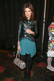 Hanneli Mustaparta injected a touch of print via a polka-dot tote.