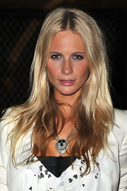 Poppy Delevingne accessorized with a chunky gemstone pendant necklace.
