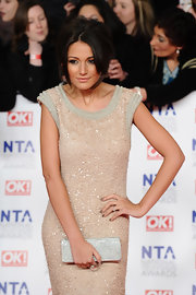 Michelle Keegan was all aglitter at the National Television Awards with this sequined clutch and gown combo.