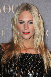 For her lips, Poppy Delevingne chose a vibrant shade of red.