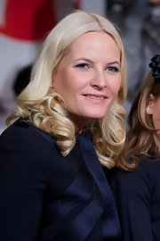 Princess Mette-Marit wore her hair in bouncy curls at the Save the Children's Peace Prize Festival.
