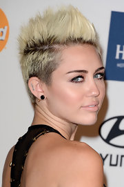 Miley Cyrus completed her bling with a gold spike earring by Emerson Ryder.