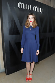 Kasia Smutniak was vintage-chic in this long-sleeve blue Miu Miu dress during the label's fashion show.