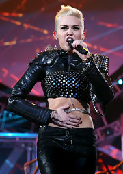 Miley Cyrus added more edge with a spiked latex bolero.