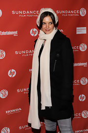 Katie Holmes teamed a white knit scarf with a black coat and a beanie for total warmth at the 2010 Sundance Film Festival.