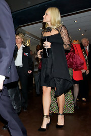 Princess Mette-Marit paired strappy black pumps with a lacy LBD for the Nobel Peace Prize Concert.
