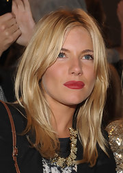 Sienna Miller swiped on some red lippy for a super-sexy pout.