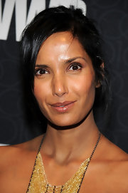 Padma Lakshmi attended the WWD 100th anniversary gala wearing this messy updo.