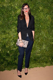 Jenna Lyons accessorized with a silver satin clutch for an elegant finish to her look.