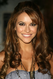 Chrishell Stause went retro glam with this teased half updo at the World Goes 'Round event.