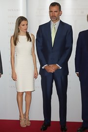 Princess Letizia styled her dress with a pair of strappy nude platform sandals.