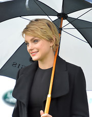 Jessica Stam accessorized with a delicate pair of dangling cross earrings.