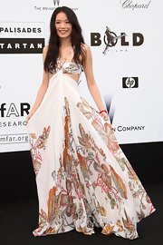 Shu Qi floated in her breezy white cut-out halter gown with butterfly printed designs at the amfAR Cinema Against AIDS benefit.