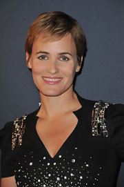 Judith Godreche attended the Pirelli 2011 Calendar launch wearing her hair in a pixie cut.