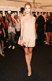 Rosie Huntington-Whiteley went for a monochromatic finish with a pair of nude knee-high boots, also by Michael Kors.