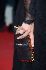 Clotilde Courau flaunted a stunning diamond cluster ring.