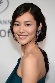 Liu Wen paired her lovely hairstyle with colorful gemstone drop earrings.