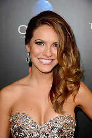 Chrishell Stause wore her hair in side-swept curls for the 2013 Daytime Emmy Awards.