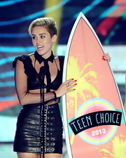 Miley Cyrus' bright red nails totally stood out against her black outfit at the 2013 Teen Choice Awards.