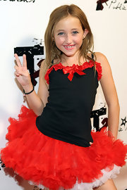 Noah Cyrus wore a beaded black bracelet with her tutu skirt and cami at the 2009 Teen Choice Awards pre-party.