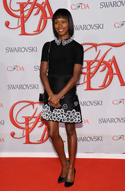 Shala Monroque looked darling at the CFDA Fashion Awards in her preppy black Jason Wu dress featuring white floral appliques on the collar and along the hem.