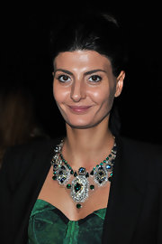 Giovanna Battaglia totally dazzled with this emerald and diamond statement necklace at the Lanvin fashion show.