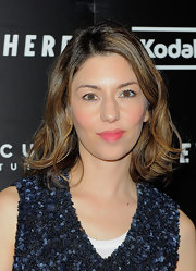 Sofia Coppola brightened up her look with pink lipstick and rouged cheeks.