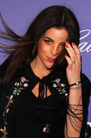 Julia Restoin-Roitfeld wore bright red nail polish for a pop of color to her black outfit at the 'L'amour Fou' premiere.