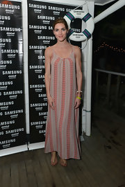 Hilary Rhoda amped up the boho feel with a pair of nude thong sandals.