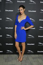Gal Gadot dazzled at the Jaguar and Playboy VIP reception in a plunging electric-blue mini dress.